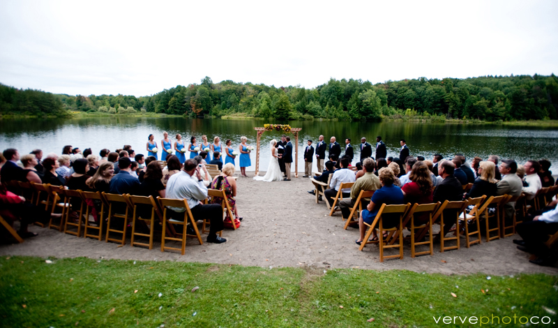 A wedding taking place at a lake.